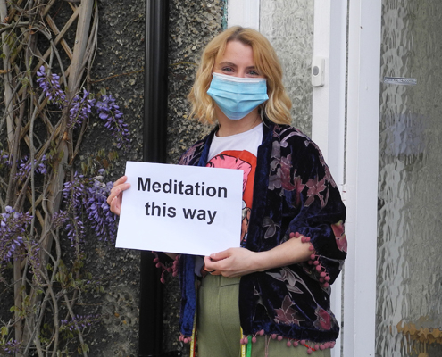 Helena with meditation this way sign